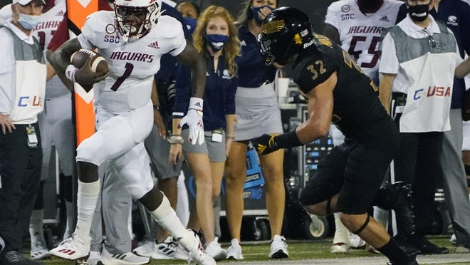 South Alabama quarterback Desmond Trotter (1) runs away from Southern Mississippi linebacker Hayes Maples (32) during the first half of a game in Sept. in Hattiesburg, Miss. Trotter will return from injury when the Jaguars host the Texas State Bobcats on Saturday.