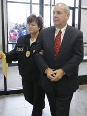 Former Pennsylvania House Speaker John Perzel, a Republican, is shown heading to a hearing in Harrisburg, Pa., in 2009.