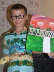 Charlie Palko of Plymouth shows off work from the Plymouth Community Arts Council summer camps.