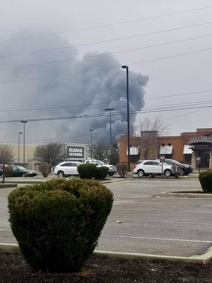 A fire severely damaged an East side business Saturday morning.