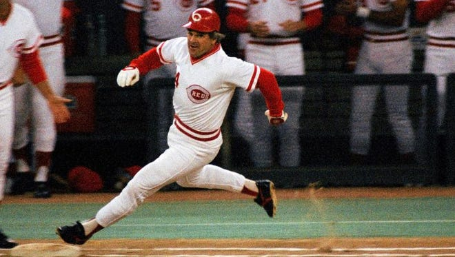 In this Sept. 11, 1985 file photo, Cincinnati's Pete Rose rounds first base after hitting a single to break Ty Cobb's hitting record.