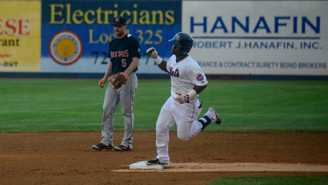 Binghamton's Dilson Herrera pumps his fist as he passes second after hitting a homerun during Thursday's game at NYSEG Stadium.