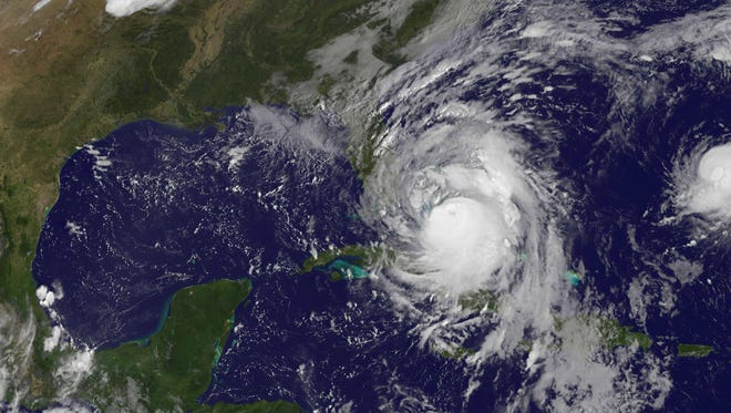 A satellite image shows Hurricane Matthew on Oct. 6, 2016, as it spins in the Caribbean.