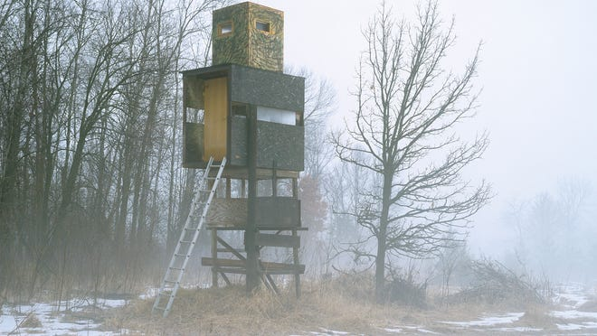 Deer stand photo by Jason Vaughn, a Madison-based photographer.