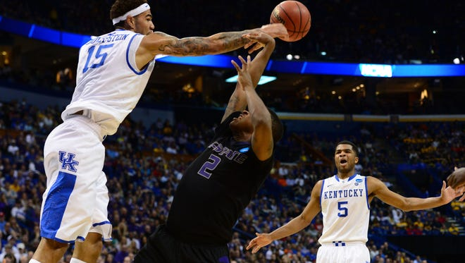 Kentucky Wildcats forward Willie Cauley-Stein blocks a shot by Kansas State Wildcats guard Marcus Foster in the first half of Friday's NCAA tournament game.