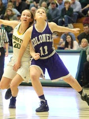 BFA's Lilly McAllister and Brattleboro's Alexandra Livanis battle for a rebound during the D1 state semifinals at UVM on Tuesday night.