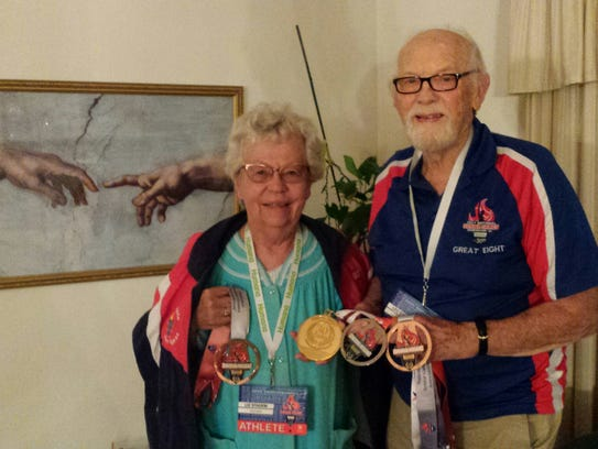 Lee and Liz Stadem hold their winning medals from the