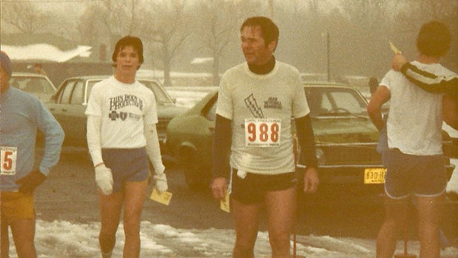 Steve Luther (left) with his father, Ray, after a Freezeroo road race in Churchville in the early 1982.