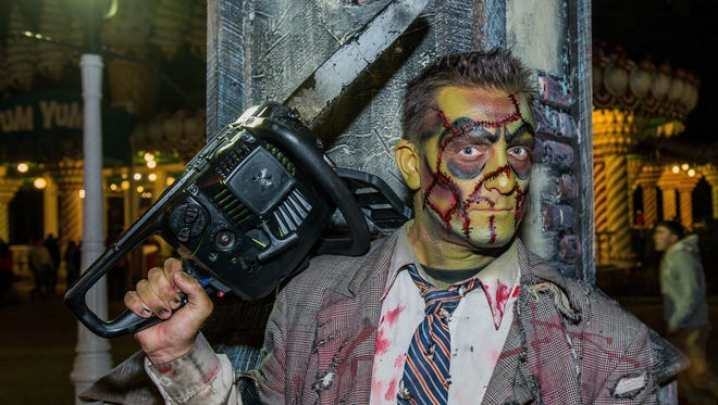 """Fright Fest offers family-friendly """"thrills by day,"""" while an amped-up """"fright by night"""" will deliver more scare zones, terror trails and haunted mazes plus nearly 200 zombies and Halloween-themed shows and attractions."""
