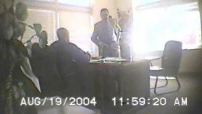 Authorities say this image from an FBI videotape shows state Sen. John Ford pocketing cash during a meeting with an undercover agent.