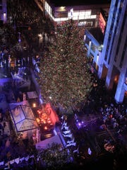 The Rockefeller Center Christmas tree stands lit at