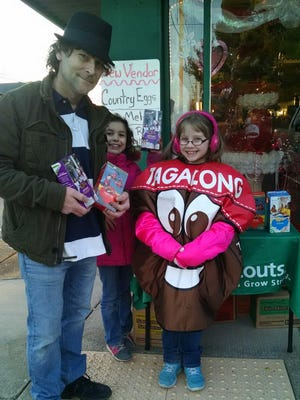 Mayor Paul Bailey taking advantage of last year's Girl Scout Cookie sales at several public places.