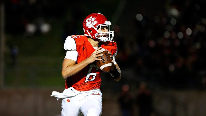 Ozartk High School quarterback Jack Hulse (6) scans the field during first quarter action of the game between Nixa High School and Ozark High School held at Tiger Stadium in Ozark, Mo. on Oct. 7, 2016.