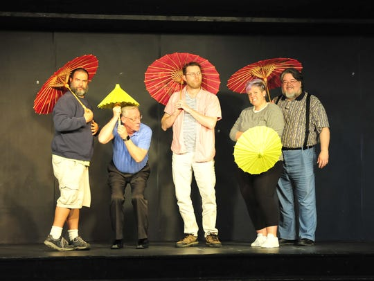 """Members of the """"Four Klunkers and a Chevy"""" improv sketch comedy group practice for a previous performance."""