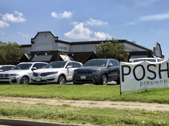 The semi-new POSH pre-owned dealership has picked up the lease for this area which allows the dealer to expand their car lot.