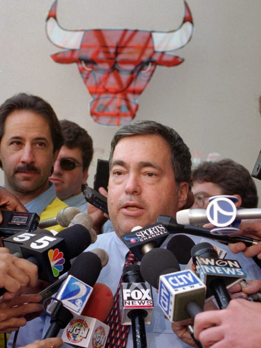 FILE - In this Oct. 2, 1995, file photo, Chicago Bulls general manager Jerry Krause speaks to the media in Deerfield, Ill., about trading center Will Perdue for the flamboyant San Antonio Spurs' Dennis Rodman. Krause, the executive behind the Bulls' six NBA titles, has died, the team announced Tuesday, March 21, 2017. He was 77.  (AP Photo/Michael S. Green, File)