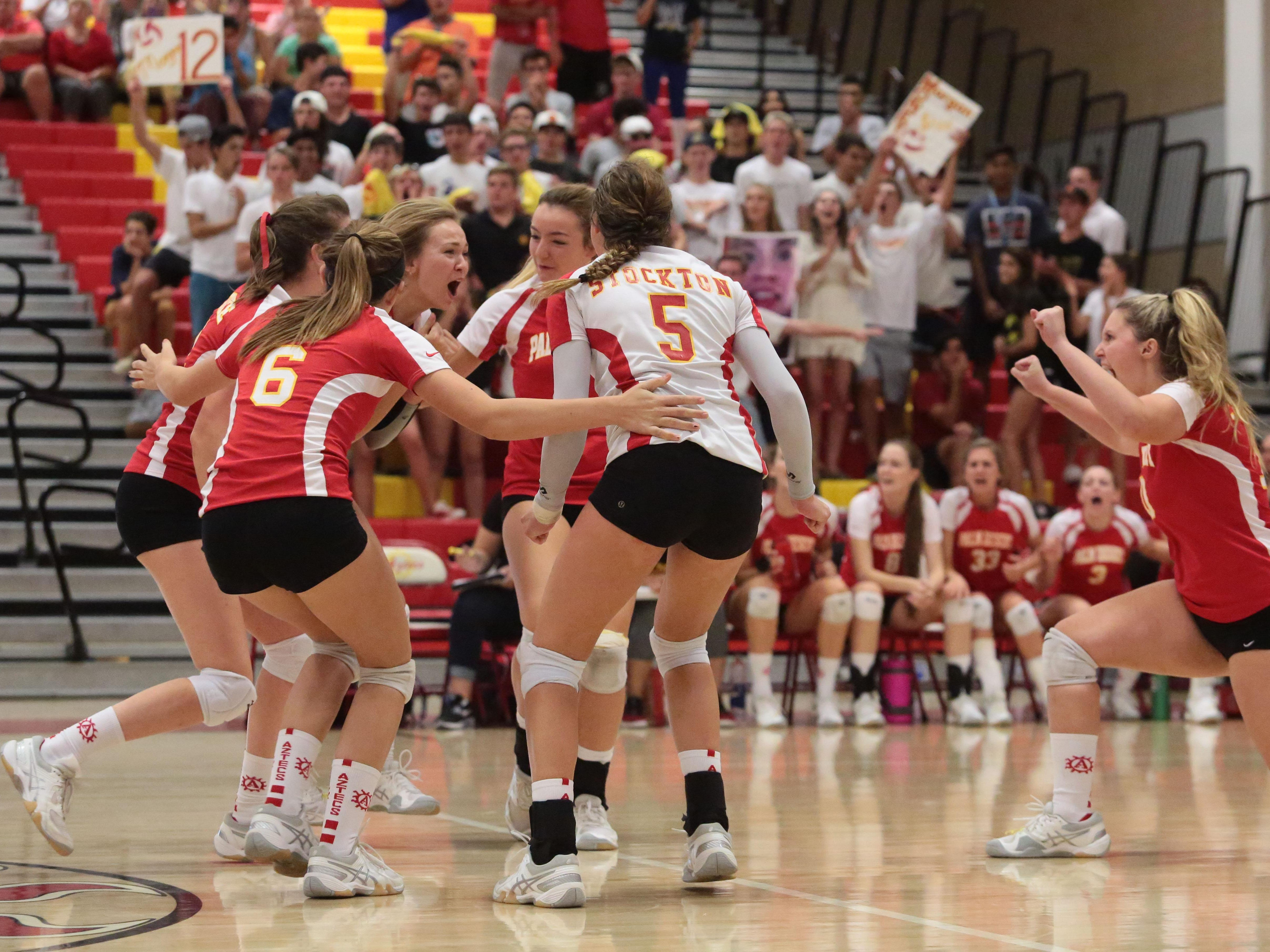 Palm Desert reacts to a point won against Palm Springs on Thursday in Palm Desert.