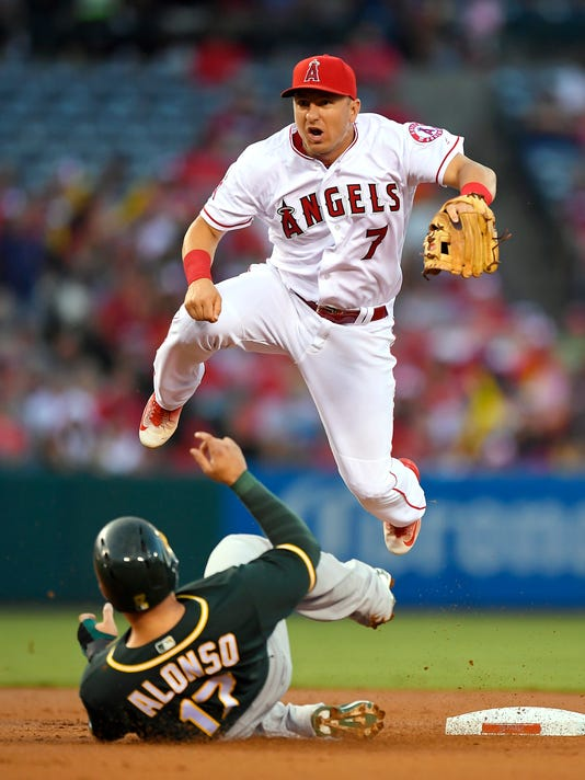 Oakland Athletics first baseman Yonder Alonso, below, is forced out at second as Los Angeles Angels second baseman Cliff Pennington watches his throw for the out on Billy Butler at first for a double play during the second inning of a baseball game, Wednesday, Aug. 3, 2016, in Anaheim, Calif. (AP Photo/Mark J. Terrill)