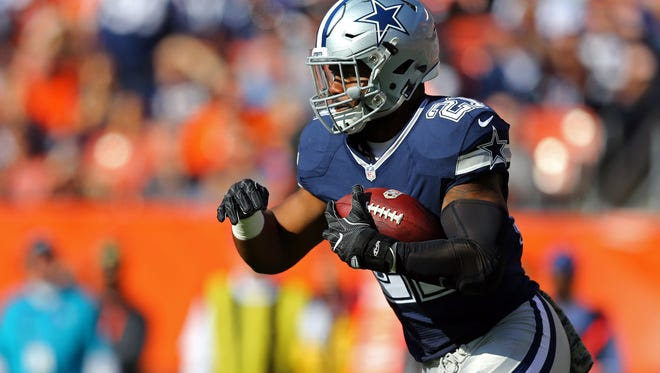 Dallas Cowboys running back Ezekiel Elliott (21) carries the ball against the Cleveland Browns in the first half at FirstEnergy Stadium.