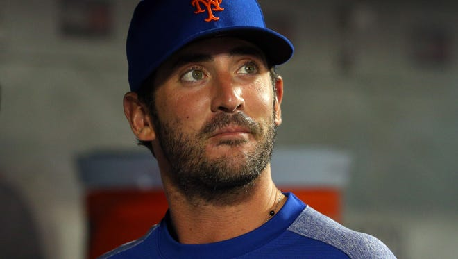 Jul 17, 2017; New York City, NY, USA; New York Mets injured starting pitcher Matt Harvey (33) in the dugout during the eighth inning against the St. Louis Cardinals at Citi Field. Harvey threw pitches in the outfield before the game. Mandatory Credit: Brad Penner-USA TODAY Sports
