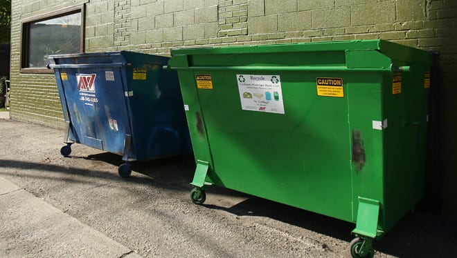 Trash and recycling dumpsters