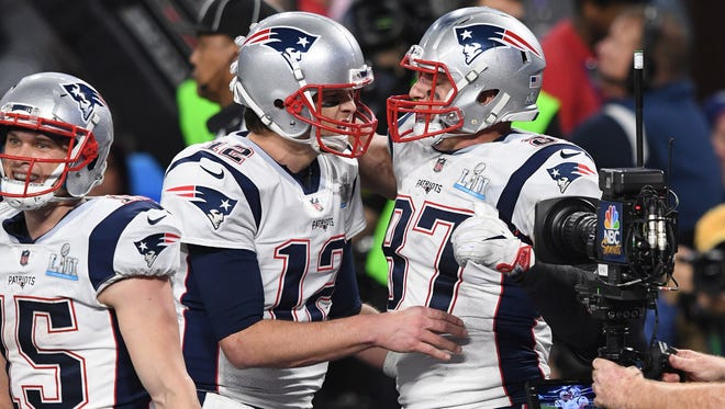 Patriots quarterback Tom Brady, left, and tight end Rob Gronkowski celebrate a fourth-quarter touchdown in Super Bowl LII vs. Philadelphia.