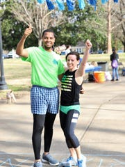 Overall race winners, Jermaine Johnson and Tammy Bond, pose for a photo at the Undie 5K Run/Walk on Saturday, March 17, 2018 on the Lambuth campus in midtown Jackson.