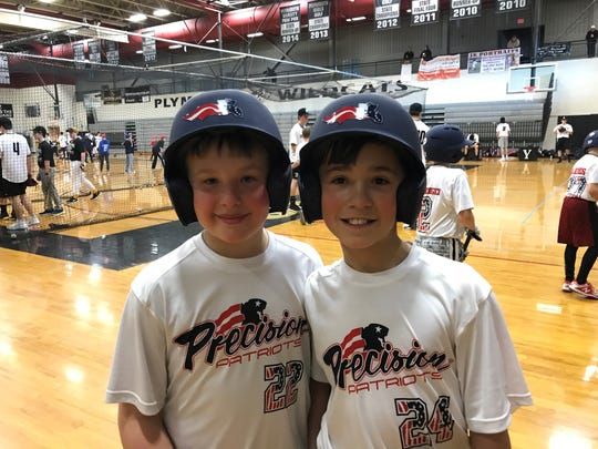 Precision Patriots baseball players (from left) Evan Jacob and Henry Wight-Young are all smiles about how the baseball clinic is going. Both are 10 years old and anxious for the season to start next month.