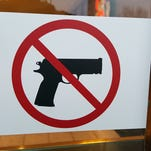 This sticker on the main entrance to The Centre at Salisbury mall makes it clear guns are not allowed inside the building.