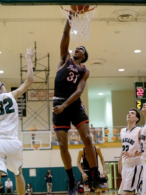 North Central Panthers Kris Wilkes (31) slams down two points against the Pendleton Heights Arabians in the second half of their game Tuesday, February 21, 2017, evening at Pendleton Heights High School. The North Central Panthers defeated the Pendleton Heights Arabians  69-58.