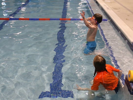 "Carter Sobush works with Rachel Koch in an individual lesson at Goldfish Swim School in Brookfield on April 12. Carter's mom, Sonya, said her son has developed a trust with his instructors: ""They're so good at keeping him comfortable."""
