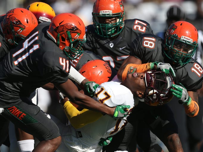 FAMU's Jacques Bryant rips off the helmet of Bethune-Cookman's