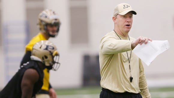 Head coach Jeff Brohm calls a play as he works with the offense during Purdue spring football practice Friday, March 31, 2017, inside the Mollenkopf Athletic Center.