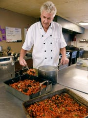 Charlie Peterka works on his roasted tomato basil and