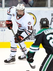 St. Cloud State's Blake Winiecki looks for a way around