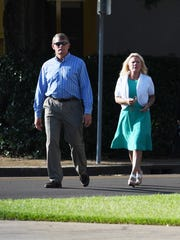 Randy and Hope Thomley of Hattiesburg prepare to enter William M. Colmer Federal Courthouse in Hattiesburg, Mississippi, to turn themselves in to federal agents on June 26, 2018. The Thomleys, with co-defendants Doyle Beach and Greg Parker, are accused of conspiring and engaging in a scheme to defraud health care insurance companies of more than $200 million. They are set for trial Jan. 8.