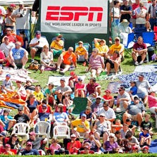 Fans gather to watch the game between the Great Lakes Region and the West Region at Lamade Stadium.
