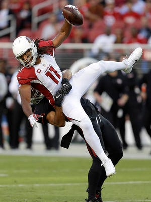 Arizona Cardinals wide receiver Larry Fitzgerald (11) is tackled by San Francisco 49ers linebacker Michael Wilhoite during the first half.