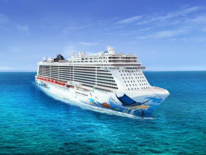 Marine artist Guy Harvey designed the hull artwork for the 4,200-passenger Norwegian Escape, which is scheduled to debut in October 2015.