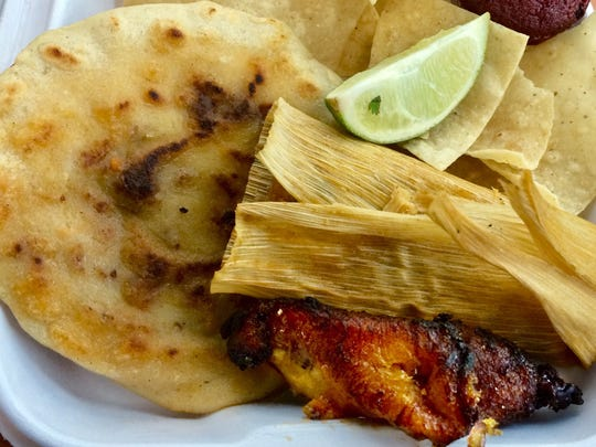 Pork-stuffed pupusa, tamale, chips and lime at the