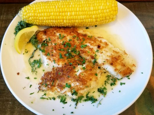 New England Fish Market's Hogfish Milanese is served