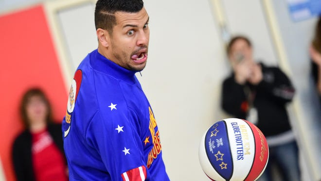 """Harlem Globetrotters' Orlando """"El Gato"""" Melendez performs  on Friday, April 1, 2016, during the presentation of """" Teach Children to Save"""" by Wells Fargo Bank and the Harlem Globetrotters at Findley Elementary."""