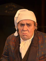 """John Welsh in the role of Scrooge in Riverfront Playhouse's production of Charles Dickens' """"The Christmas Carol."""""""