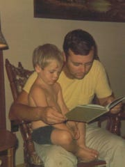 """A young Nick Offerman with his father Ric. """"Dad is a great dad because he taught me values and gave me a work ethic and good manners and manged to show me a good time all the while,"""" says Offerman."""