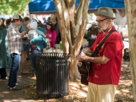 Kent Stanton plays for the crowd March 31 at Palafox Market in downtown Pensacola. Palafox Market will be celebrating its 11th anniversary from 9 a.m. to 2 p.m. Saturday.