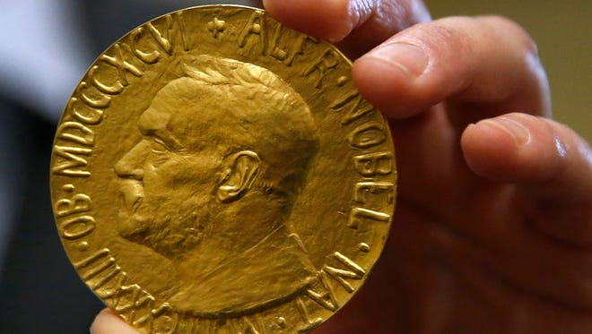 Ole Bjorn Fausa of Norway holds the 1936 Nobel Peace Prize in Baltimore on March 27, the second Nobel Peace Prize ever to come to auction.