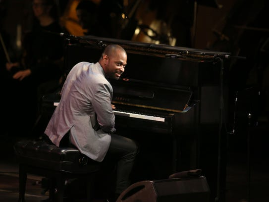 Michael Mitchell plays the piano for Leslie Odom Jr.'s