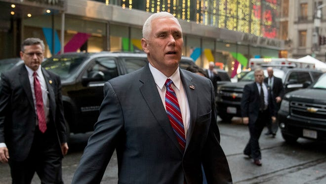 Vice President-elect Mike Pence arrives at Trump Tower in New York on Tuesday.