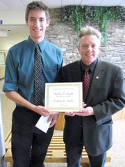 Pennsylvania House Rep. Russ Diamond (R-102) presents Colton Herb, a senior at Northern Lebanon High School, with a certificate declaring him the winner of the 2016 Walter L. Smith Memorial Scholarship.