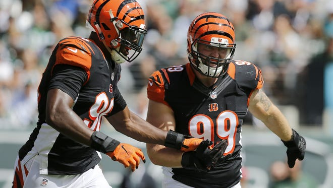 Cincinnati Bengals defensive end Carlos Dunlap, left, and defensive end Margus Hunt celebrate Hunt's first blocked field goal in the first quarter of the Bengals 23-22 victory over the New York Giants on Sept. 11.